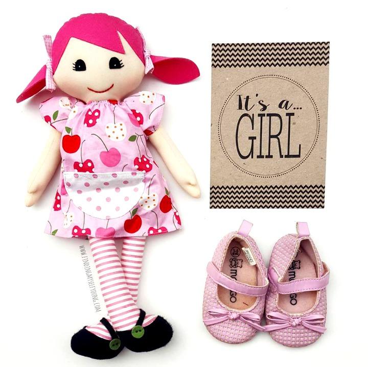 baby girl gender reveal flatlay