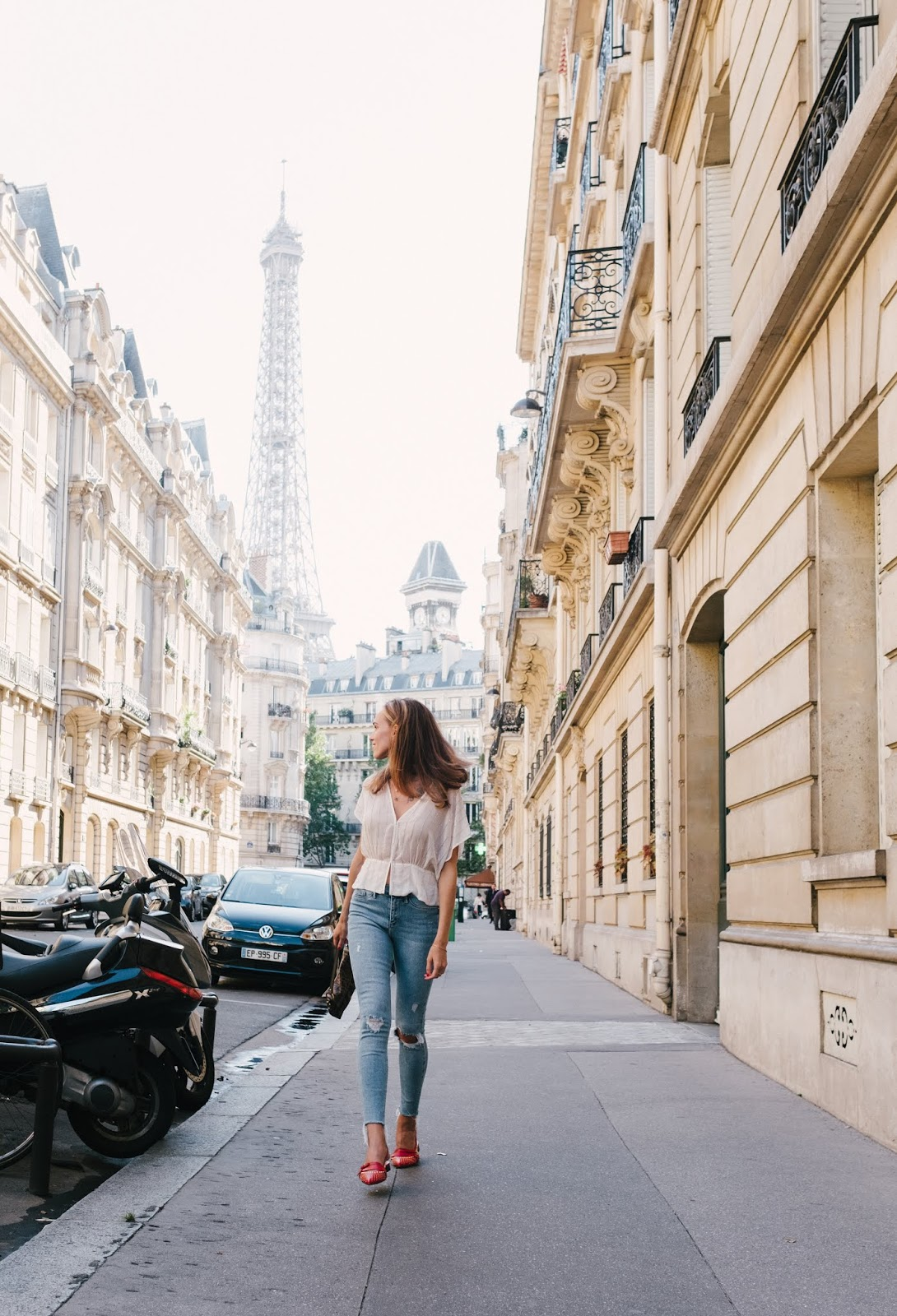 parisian street style outfit summer white pearl top jeans