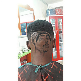 25037877 1928784040720412 7990308869161091072 n 696x696 - Meet The Best Barber In Nigeria, He Carved Davido And Wizkid's Faces On Heads