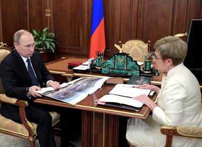 Vladimir Putin and Marina Kovtun.