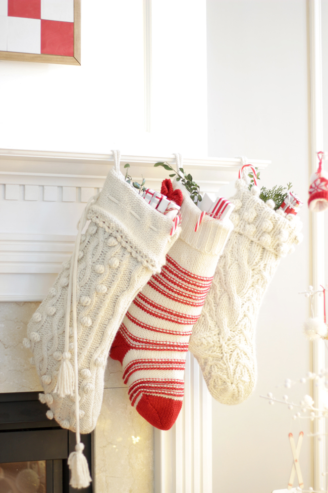 pom poms and red and white Christmas stockings