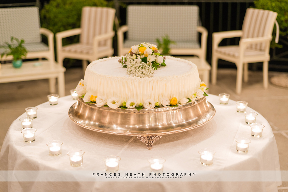 Wedding cake with white and yellow flowers