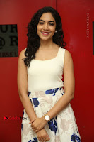 Actress Ritu Varma Stills in White Floral Short Dress at Kesava Movie Success Meet .COM 0044.JPG