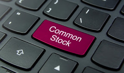 Common Stock in keyboard