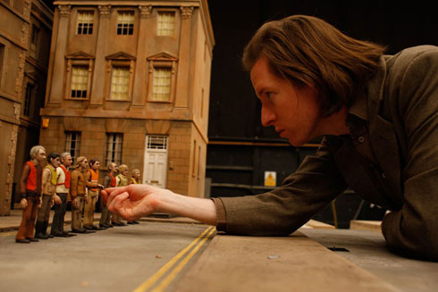 Wes Anderson adjusting character figures in Fantastic Mr. Fox animatedfilmreviews.filminspector.com
