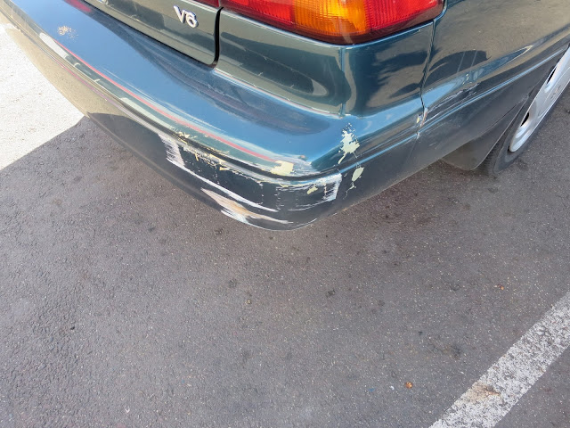 Scraped bumper on Camry before auto painting at Almost Everything Auto Body