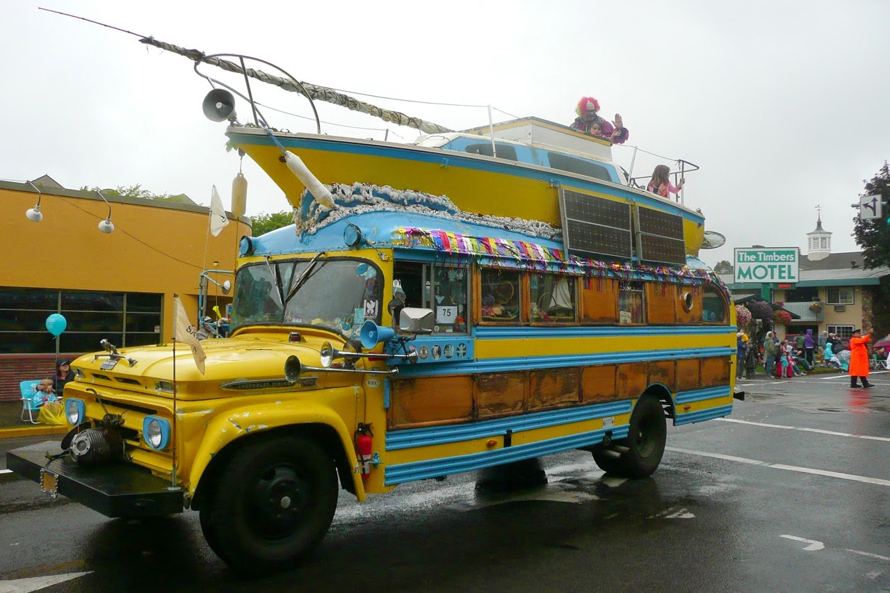Eugene Celebration parade, float, hippie bus, boat on bus, downtown traffic