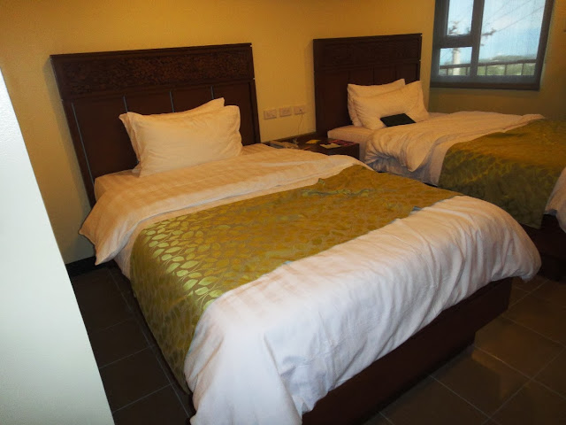 Two Twin size bed inside Canyon Woods hotel