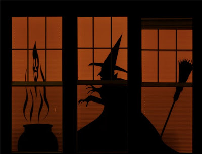 spooky witch, broom, and cauldron halloween silhouettes in window