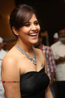 Telugu Anchor Actress Anasuya Bharadwa Stills in Strap Less Black Long Dress at Winner Pre Release Function  0022.jpg