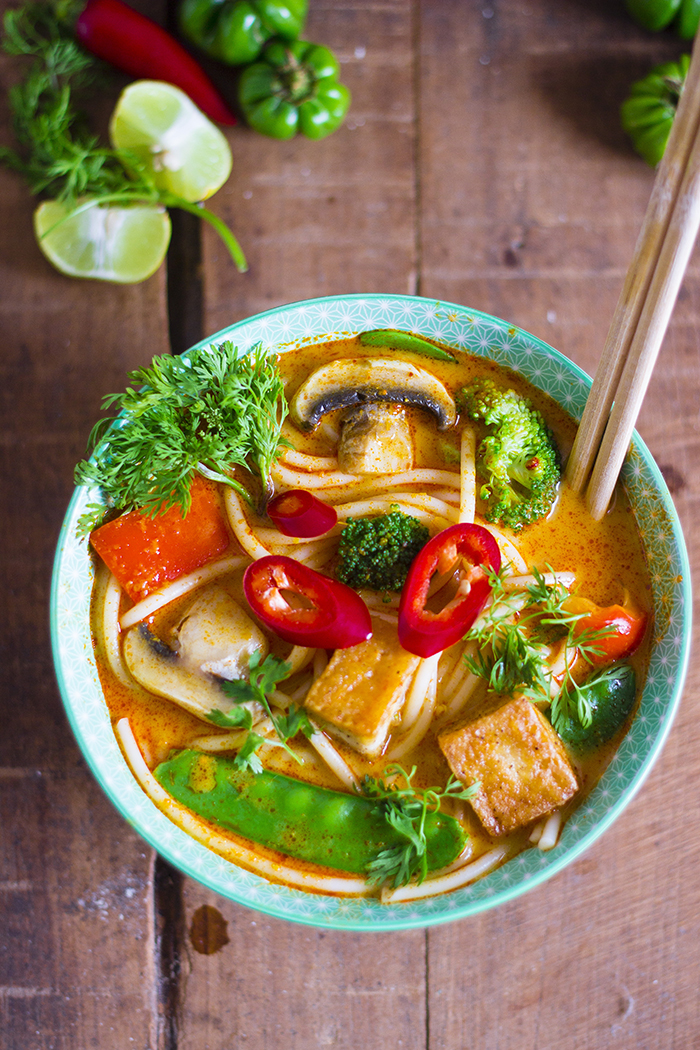 Malaysian Laksa Lemak or Curry Laksa. Vegan spicy asian noodle soup