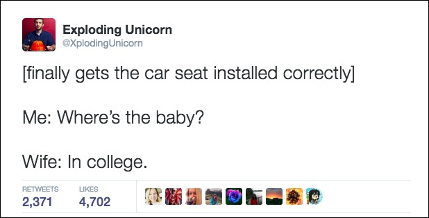 father installs baby seat in car