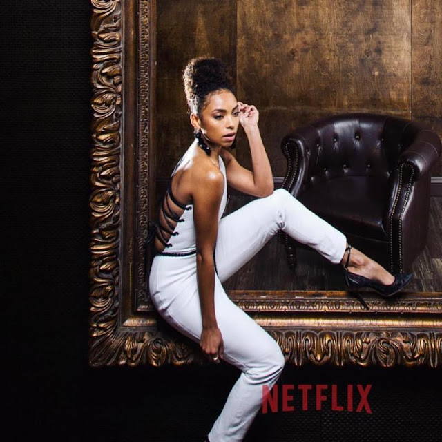 Logan Browning white jump suit