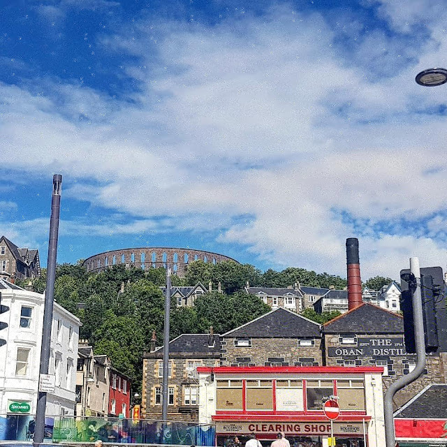 McCaig's Tower, looking like a mini-colosseum, looks over the town of Oban