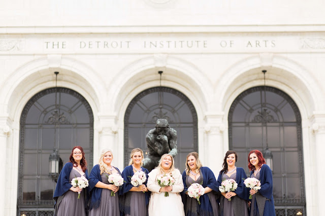 bridesmaids at detroit institute of arts laughing