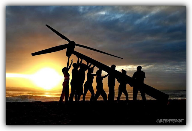 People Hoisting Wind Turbine