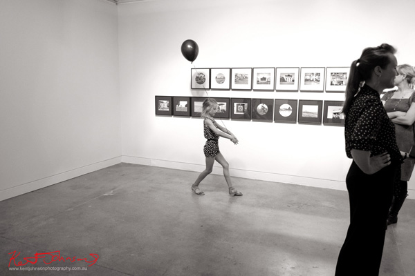 A child with a black balloon at Jane Brown's, Sporting Country show, Stills Gallery.