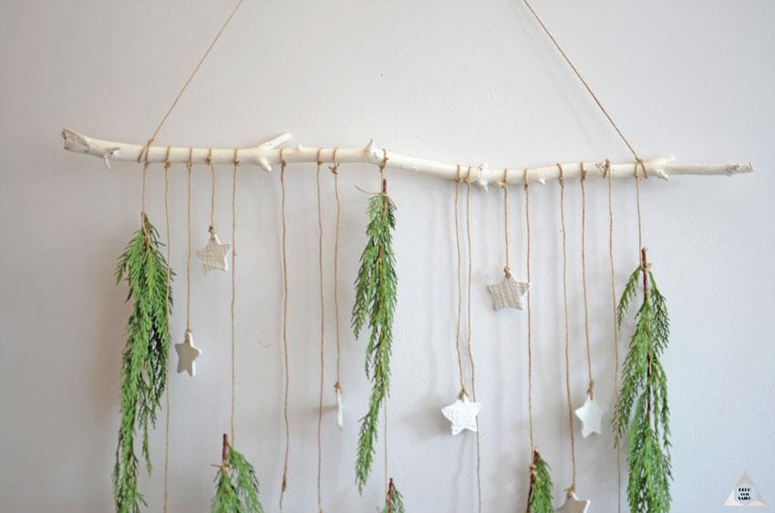 decoracion navideña con estrellas y ramas