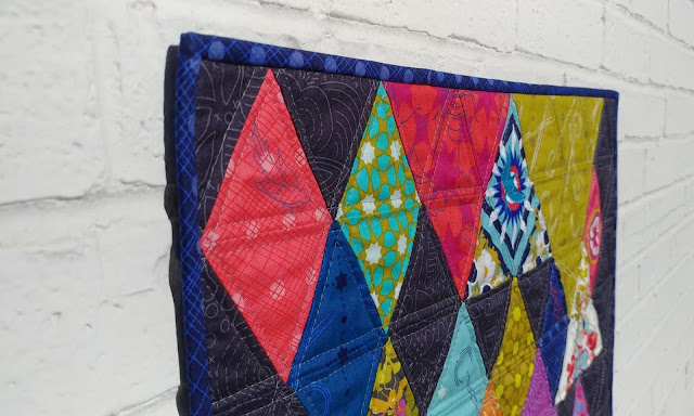 End Game mini quilt with fussy cut Seventy-Six fabrics by Alison Glass