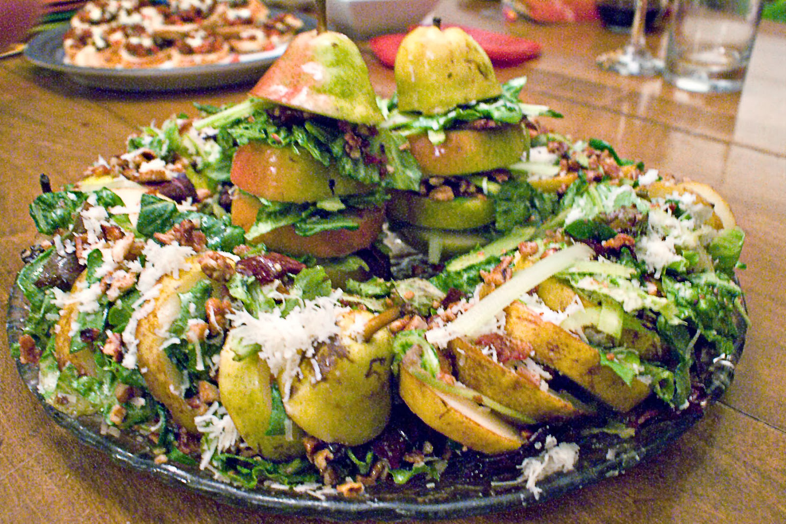 Pear salad with bacon, pecans, baby greens, and manchego cheese