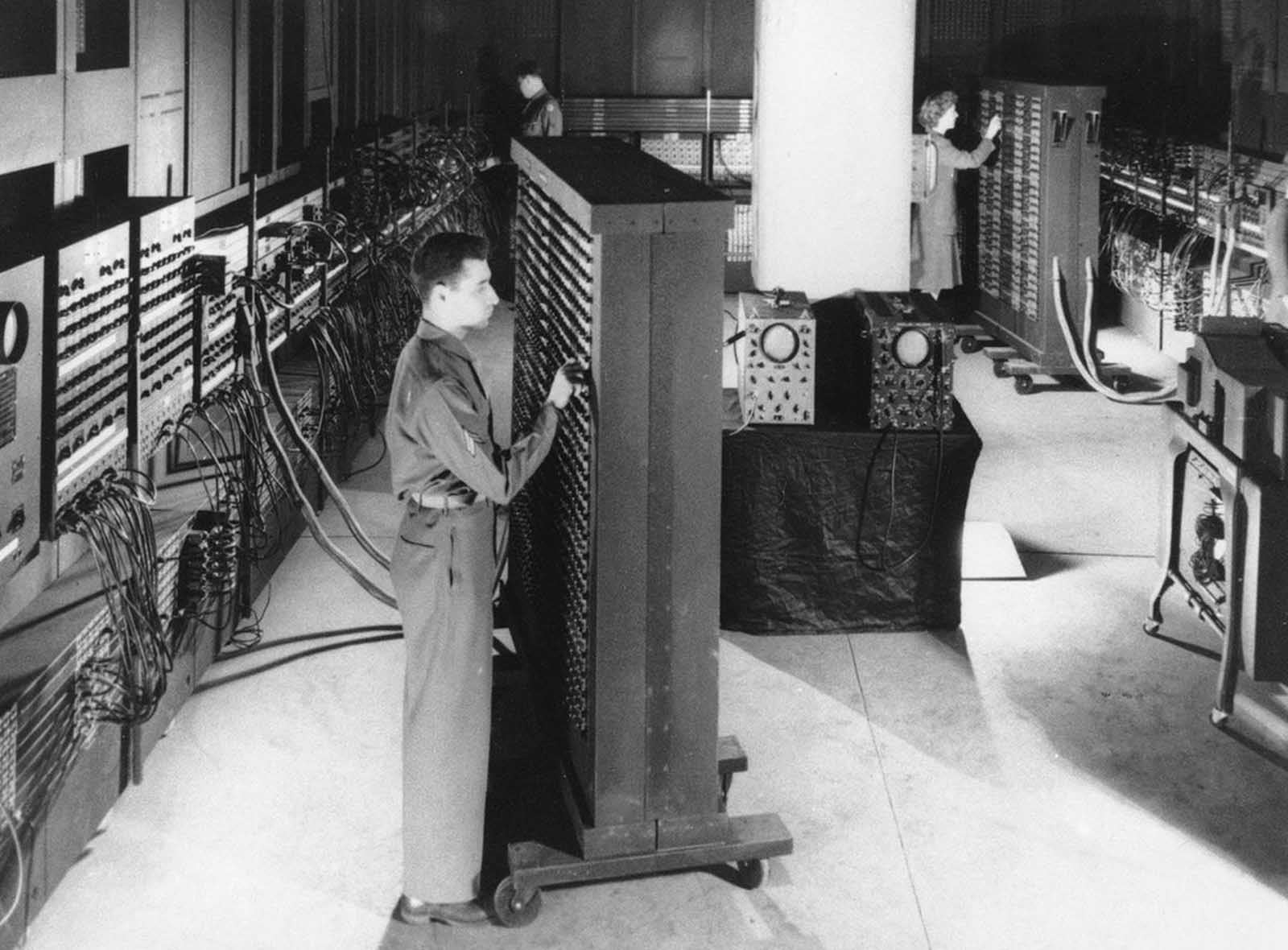 This 1946 photograph shows ENIAC (Electronic Numerical Integrator And Computer), the first general purpose electronic computer - a 30-ton machine housed at the University of Pennsylvania. Developed in secret starting in 1943, ENIAC was designed to calculate artillery firing tables for the United States Army's Ballistic Research Laboratory. The completed machine was announced to the public on February 14, 1946. The inventors of ENIAC promoted the spread of the new technologies through a series of influential lectures on the construction of electronic digital computers at the University of Pennsylvania in 1946, known as the Moore School Lectures.