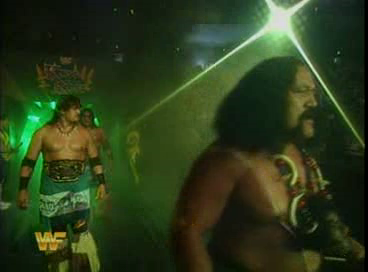 WWF / WWE - King of the Ring 1994: Afa leads WWF Tag Team Champions The Headshrinkers down to the ring for a match against Yokozuna and Crush