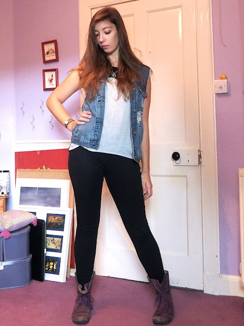 Rock 'n' Roll - grunge rock outfit of ripped denim waistcoat, loose grey t-shirt, black skinny jeans, and purple combat boots