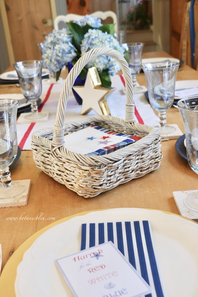 set a stars and stripes patriotic table with a star Christmas ornament