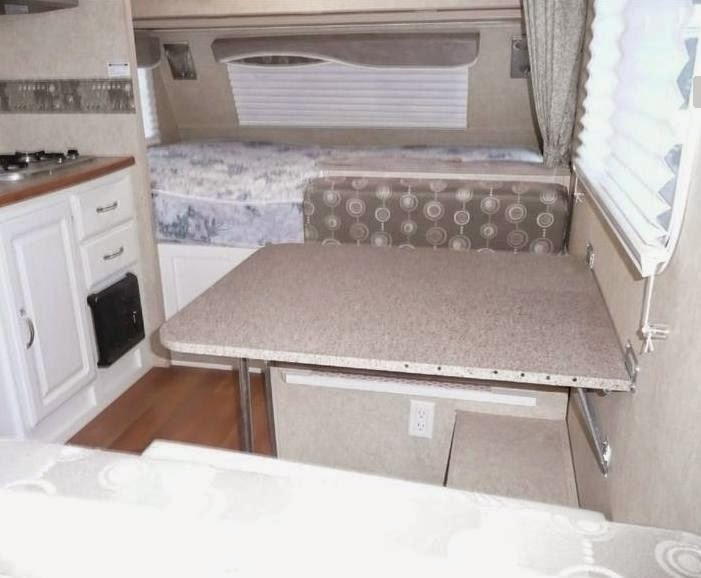 cramped dinette - get rid of it and make a couch - see the demo here!