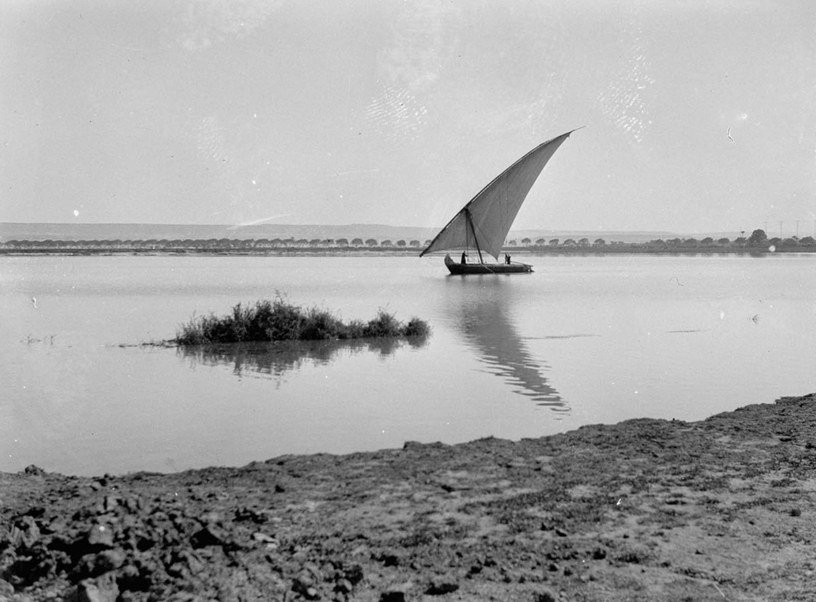 A boat sails down the Nile. 1934.