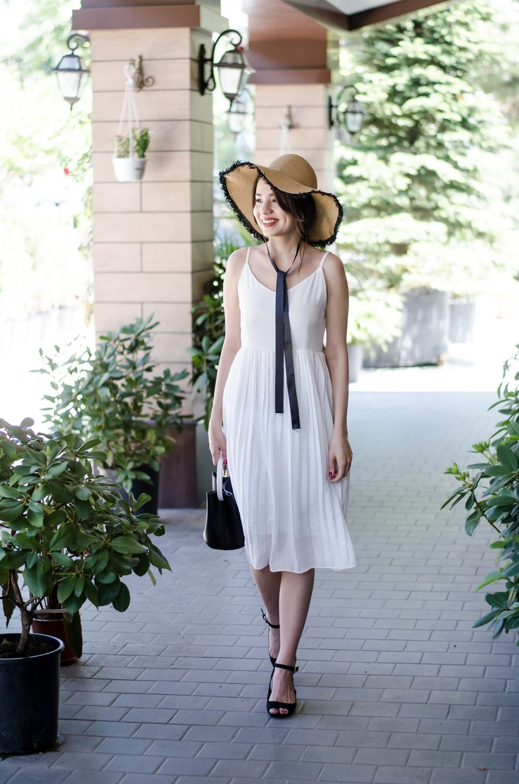 diyorasnotes diyora beta fashion blogger style outfitoftheday lookoftheday pleated midi dress white dress heels oversized straw hat
