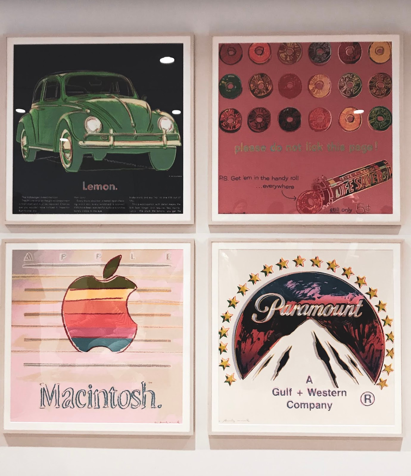 4 photoframes in Whitney Museum of American Art vintage Apple logo, Paramount logo, a car
