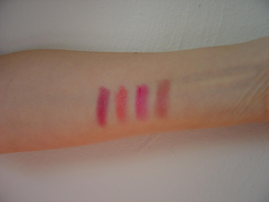 swatches of four Get It All Lip Color Lipsticks (400 Extraordiberry, 101 Exeptionude, 600 Terrificoral, 202 Fabfuchsia).jpeg