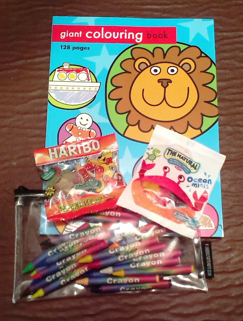 Coloring book and crayons present