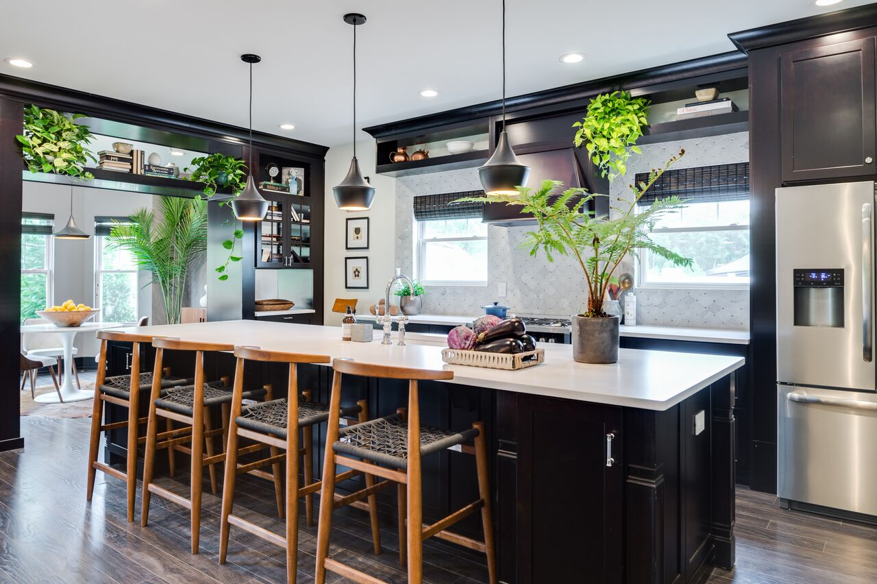 Eclectic black and white kitchen with modern wood barstools