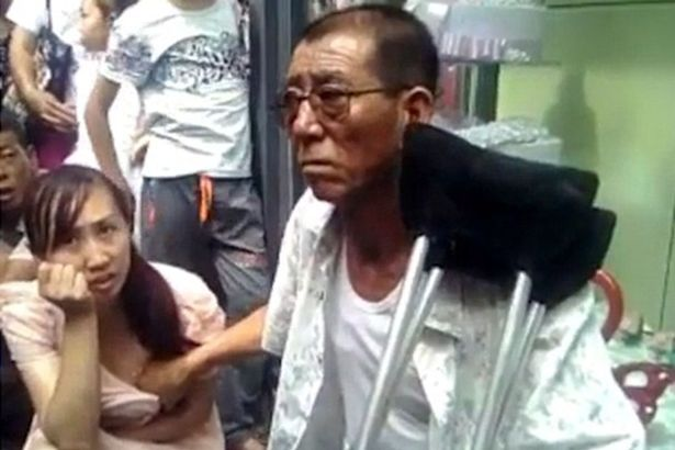 Chinese Breast Fondling Clairvoyant Claims To Accurately Predict A Woman's Future