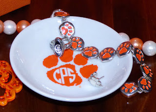 http://shop.clemsongirl.com/collections/frontpage/products/monogram-paw-ring-dish-square-or-round