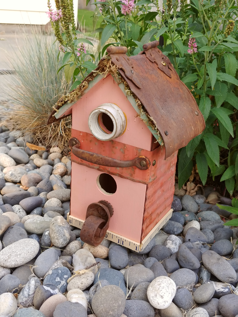 birdhouse with rusty pieces