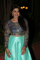 Nikki Galrani in Green Skirt  Top at Marakathamani music launch ~  Exclusive (25).JPG