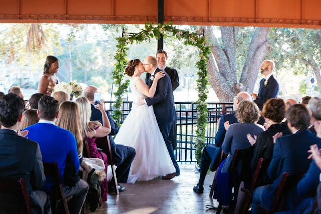 bride and groom say i do at altar