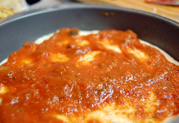 pizza dough and spaghetti sauce