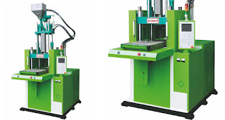 Sliding table vertical injection machine