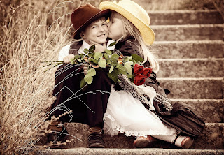 small boy and girl flower in hand kiss wallpapers.jpg