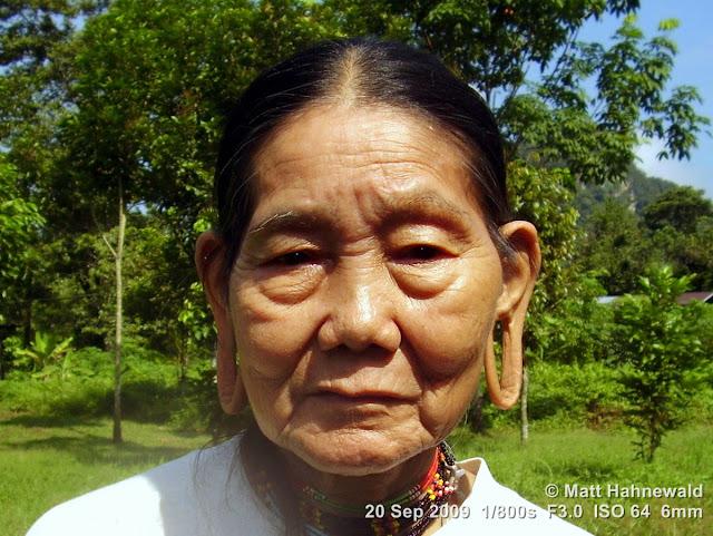Penan woman, street portrait, headshot, elongated earlobes, stretched earlobes, holes in earlobes, Borneo, Sarawak, Gunung Mulu National Park, Batu Bungan