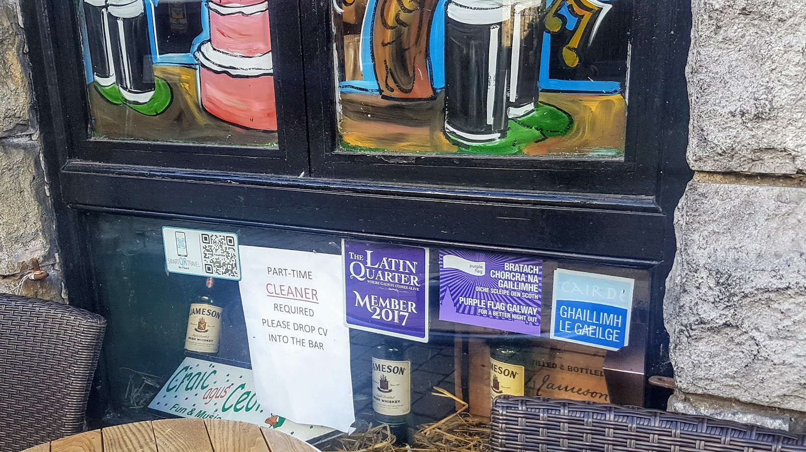 Other signs in the same window:  Latin Quarter member 2017, Ghaillimh le Gailege, Purple flag galway, Jamieson whiskey, Craic agus ceol (obscured)