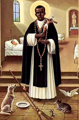 Imagen de San Martín de Porres con la cruz de Jesús