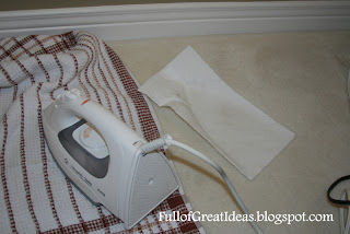 how to get wax out of carpet with an iron