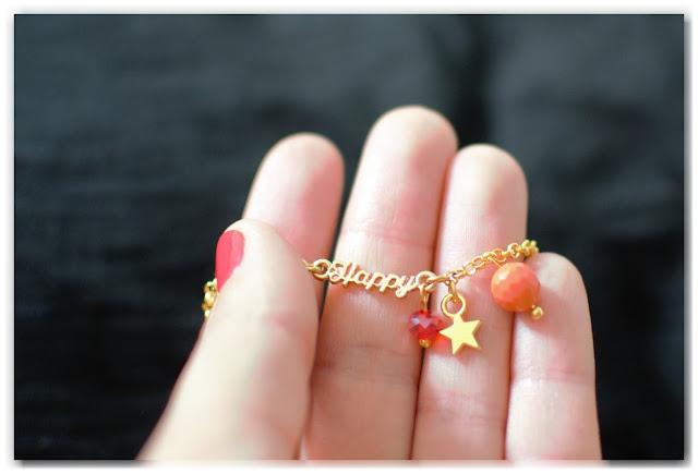 bracelet gourmette happy doré orange et rouge