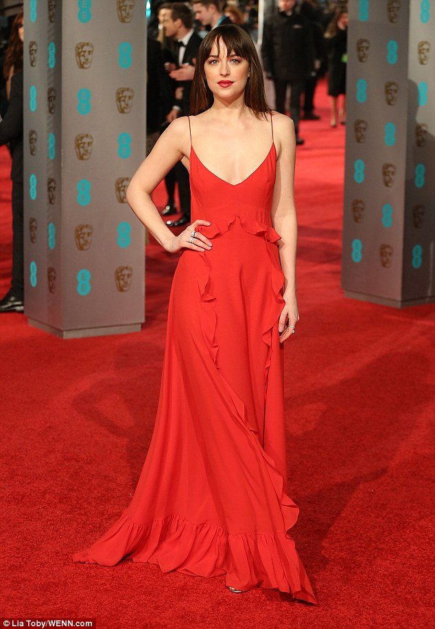 Dakota Johnson goes braless in red at the BAFTAs 2016