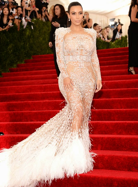 Kim Kardashian flashes skin in a daring Roberto Cavalli gown at the 2015 Met Gala